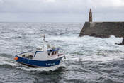 Asturian octopus fishing boat at Cantabrian seahore
