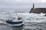 Asturian octopus fishing boat at Cantabrian seahore