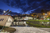 Sunrise landscape at Viavelez fishing port of Asturias