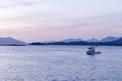 MSC AIR salmon - fishing boat at sunset with mountains