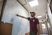 Travis Elison demonstrating on map, Alaska Department of Fish and Game | Wild Alaska Salmon Fishery Visit, Bristol Bay
