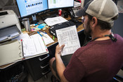 Travis Elison showing paperwork, Alaska Department of Fish and Game | Wild Alaska Salmon Fishery Visit, Bristol Bay