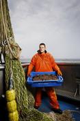 Jan Marcus holding tray orange oil skins Dutch