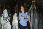Emily Taylor in garage with fishing gear | Wild Alaska Salmon Fishery Visit, Bristol Bay