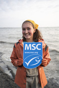 Emily Taylor with MSC ecolabel sign | Wild Alaska Salmon Fishery Visit, Bristol Bay