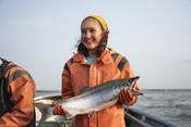 Emily Taylor smiling with salmon | Wild Alaska Salmon Fishery Visit, Bristol Bay