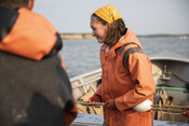 Emily Taylor smiling while pulling net in | Wild Alaska Salmon Fishery Visit, Bristol Bay