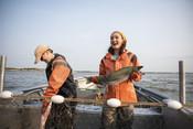 Emily Taylor smiling holding fish | Wild Alaska Salmon Fishery Visit, Bristol Bay