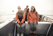 Emily Taylor and Melissa smiling on fishing boat | Wild Alaska Salmon Fishery Visit, Bristol Bay