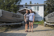 Emily and family in front of fishing boats on land | Wild Alaska Salmon Fishery Visit, Bristol Bay