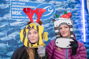 People in MSC photo booth during winter event for consumers
