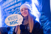 "MSC educator holding ""Choose MSC"" sign during winter consumer event"