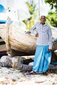 Maldivian fisherman gutting fish