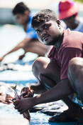 Maldivian fisherman sitting on boat
