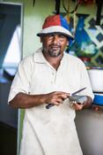 Maldives fisherman sharpening knife