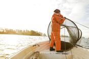 Fishermen Anna Vesper Gunnarsson fishing pikeperch in Lake Hjälmaren in Sweden