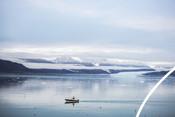 A fishing boat in Kongsfjorden bay outside Ny-Ålesund, Svalbard.